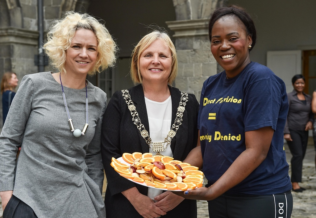 Street feast organizer Michelle Darmody with The Lord Mayor of Dublin, Críona Ní Dhálaigh and Ellie Kisyombe at the Our Table Street Feast celebrations in IMMA prepared by residents of direct provision.