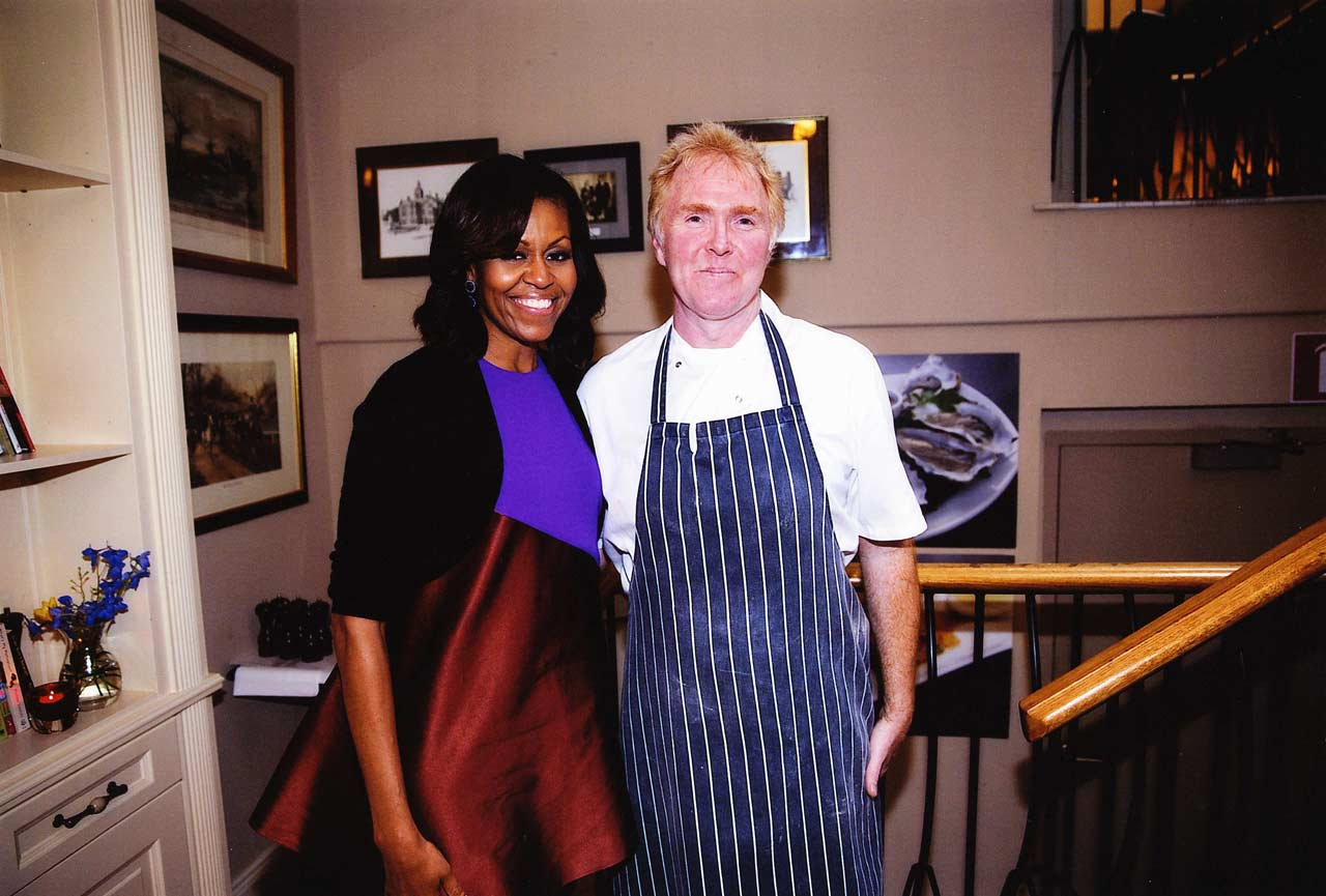 Former first lady Michelle Obama pictured in Matt the Threshers Dublin branch in 2013.